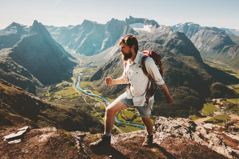 Man tourist with backpack hiking on mountain ridge royalty free stock image