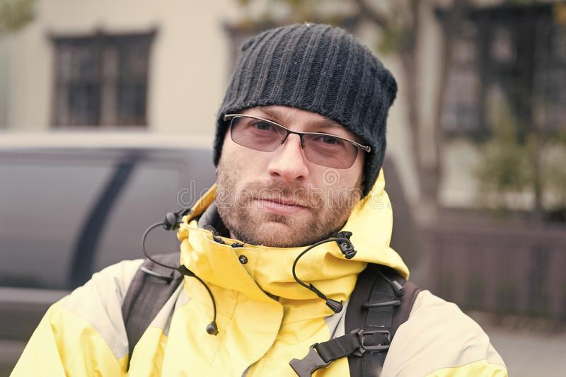 Man tourist with backpack outdoor. pick me up. tips of experienced backpacker. man backpacker waiting for travel car stock images