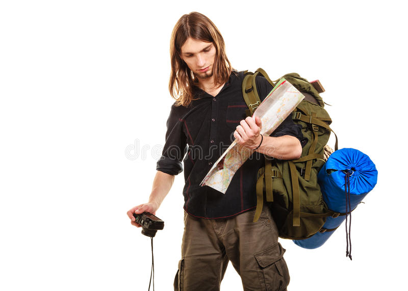 Man tourist backpacker with camera reading map. royalty free stock images