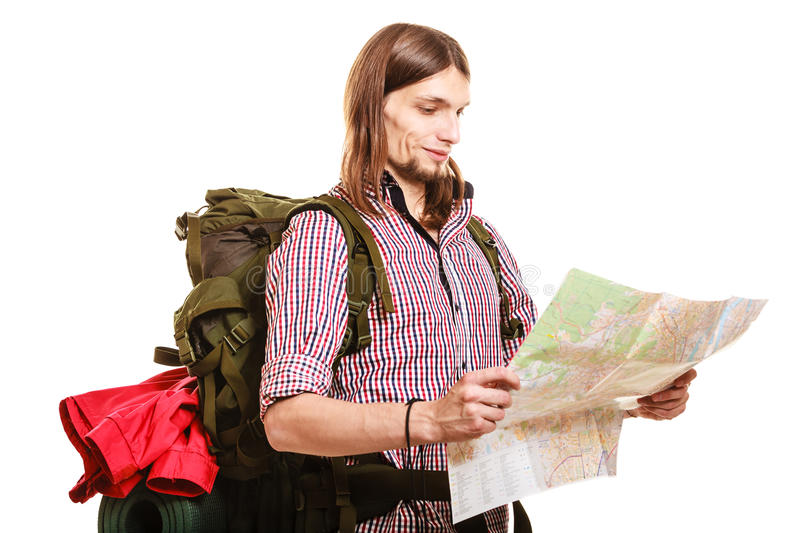 Man tourist backpacker reading map. Summer travel. royalty free stock photography