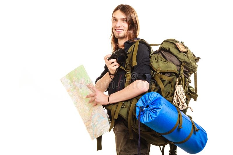 Man tourist backpacker taking photo with camera stock image
