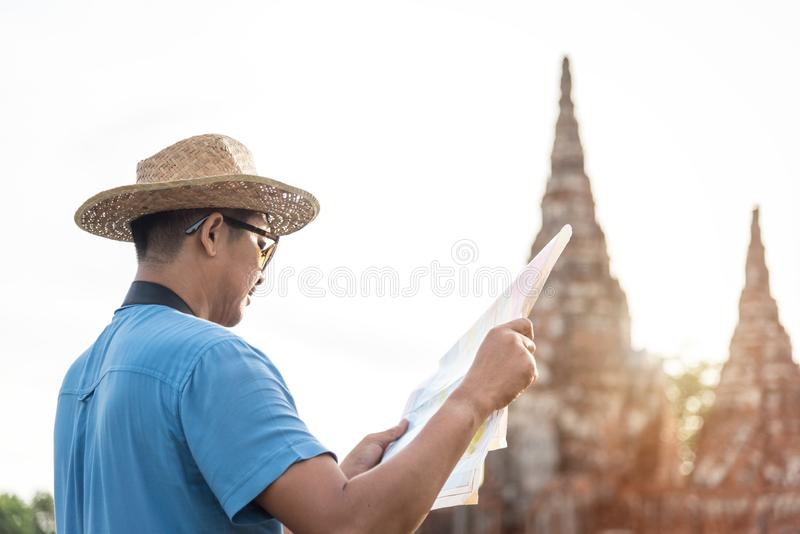Man tourist looking map at Wat Chaiwatthanaram temple. Travel in old city of Ayutthaya, Thailand. Asia tourist stock images
