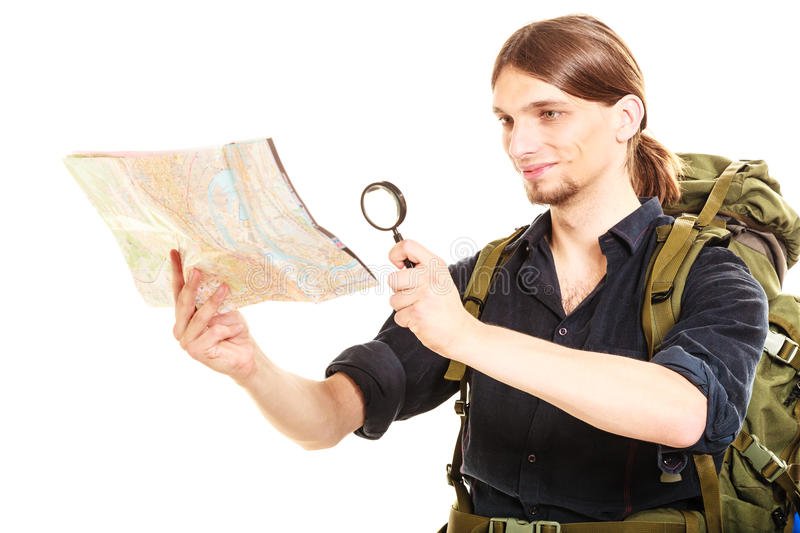 Man tourist reading map with magnifying glass royalty free stock images