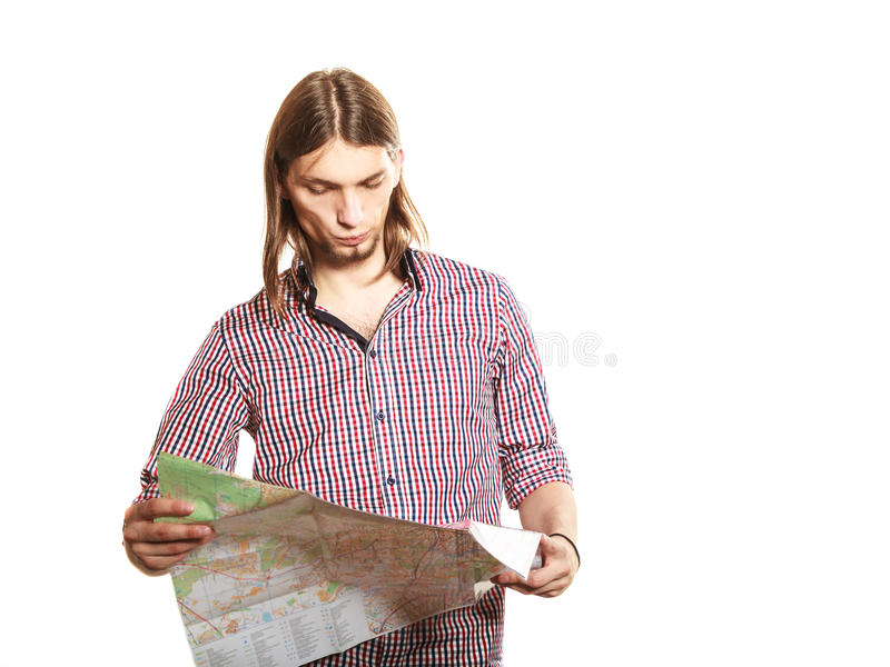 Man tourist reading map on trip. Summer travel. royalty free stock photography