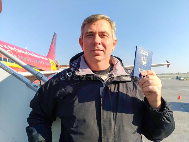 Man tourist with Ukrainian biometric passport stock images