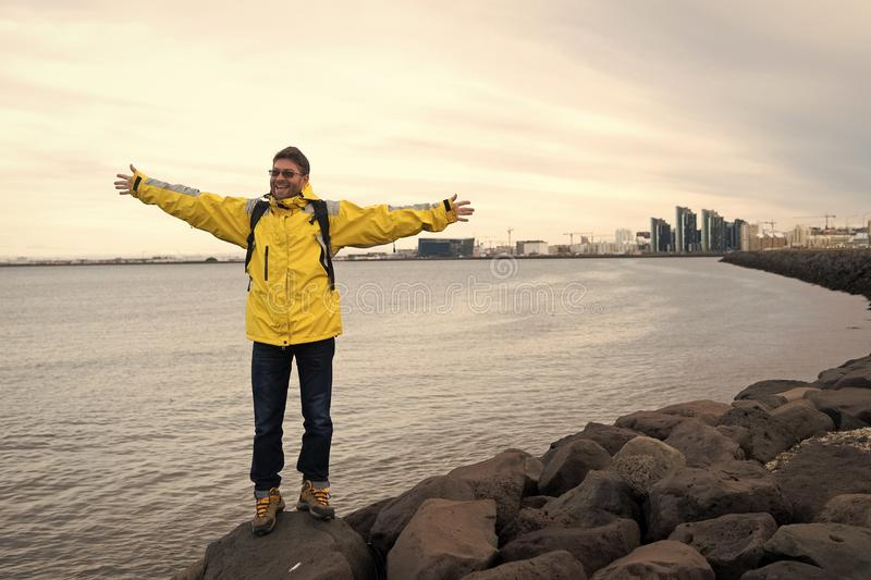 Man tourist wear warm protective clothes for cold climate conditions. Tourist well equipment ready explore scandinavian royalty free stock images