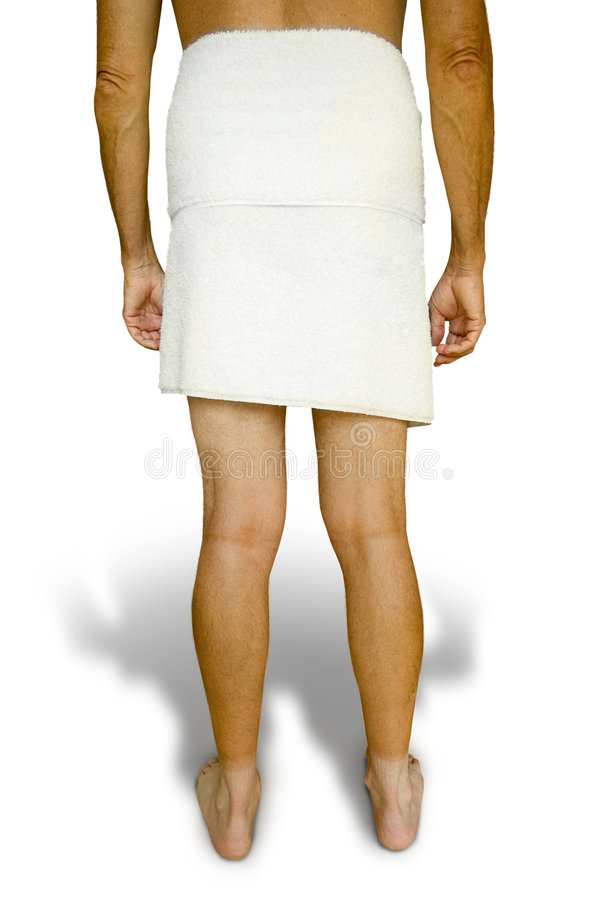 Man in towel. A man standing in a towel with his back towards the viewer. Could be used to show a situation displaying an uncomforatble position stock photos