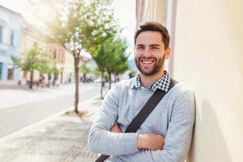 Man in town. Handsome young man on a walk in town stock photography