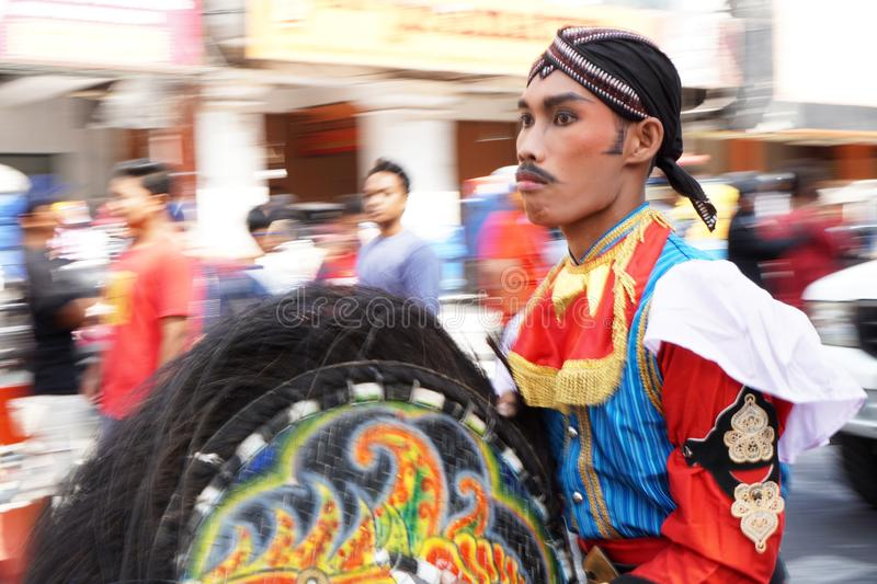 Man in traditional costumes are parading on Malioboro street, Yogyakarta. Photos taken with panning techniques. Yogyakarta, Indonesia. September 23, 2018. Man in royalty free stock photo