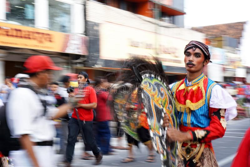 Man in traditional costumes are parading on Malioboro street, Yogyakarta. Photos taken with panning techniques. Yogyakarta, Indonesia. September 23, 2018. Man in stock photos