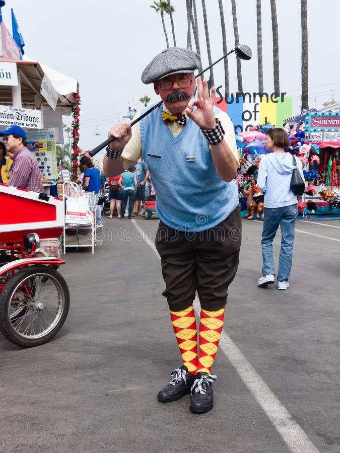 Man traditional golfers costume, county fair. Man with mustache, golf clug, dressed in old fashioned, traditional golfers clothing at San Diego County Fair stock images