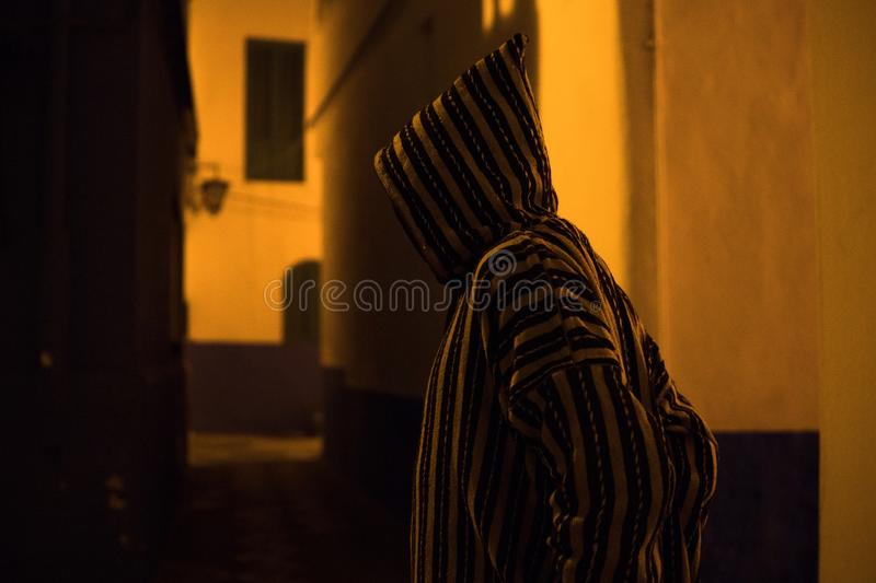 Man in Traditional moroccan djellaba walking on the street of Asilah Medina, on Atlantic Coast in Morocco stock photos