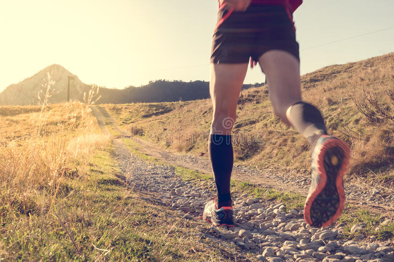 Man trail running on the mountains royalty free stock photo