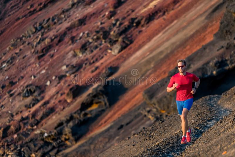 Man trail running in mountains. Runner on run. Fitness and health active lifestyle. Man trail running in mountains. Runner on outdoor run. Fitness and health royalty free stock images