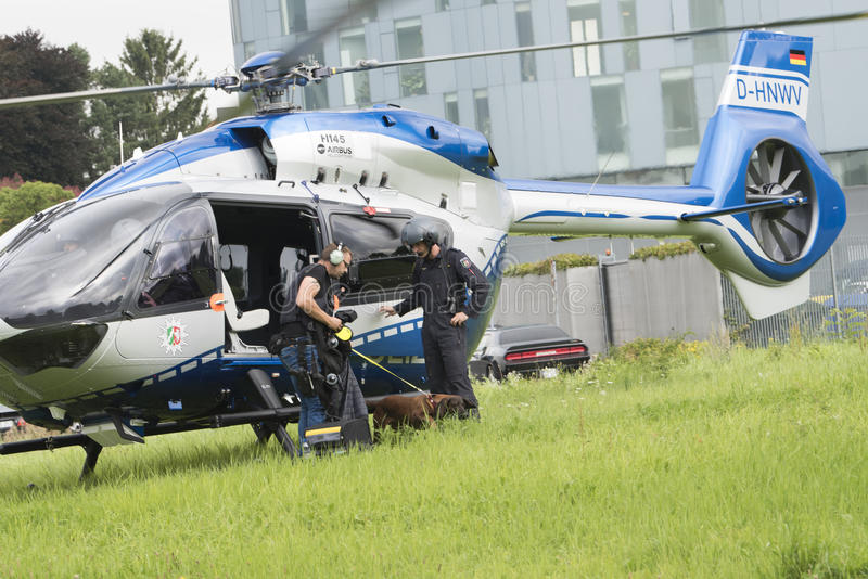 Man-trailing dog coming out Police Helicopter royalty free stock photos