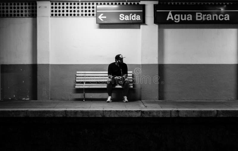 Man on train platform stock photo