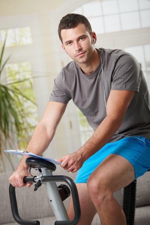 Download Man Training On Exercise Bike Royalty Free Stock Photo - Image: 13642555