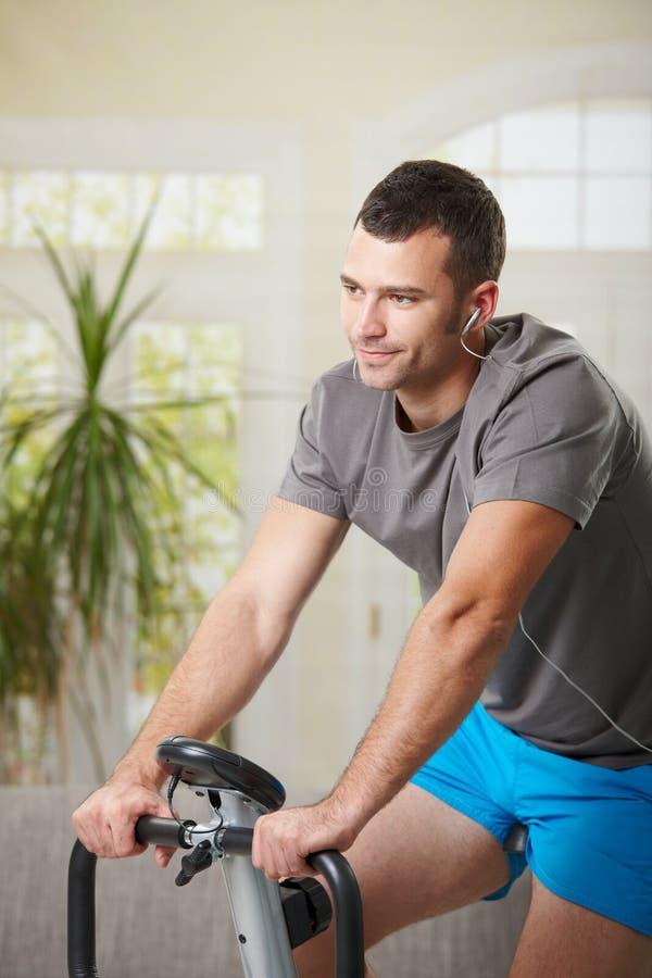 Download Man Training On Exercise Bike Stock Image - Image of hear, body: 20941145