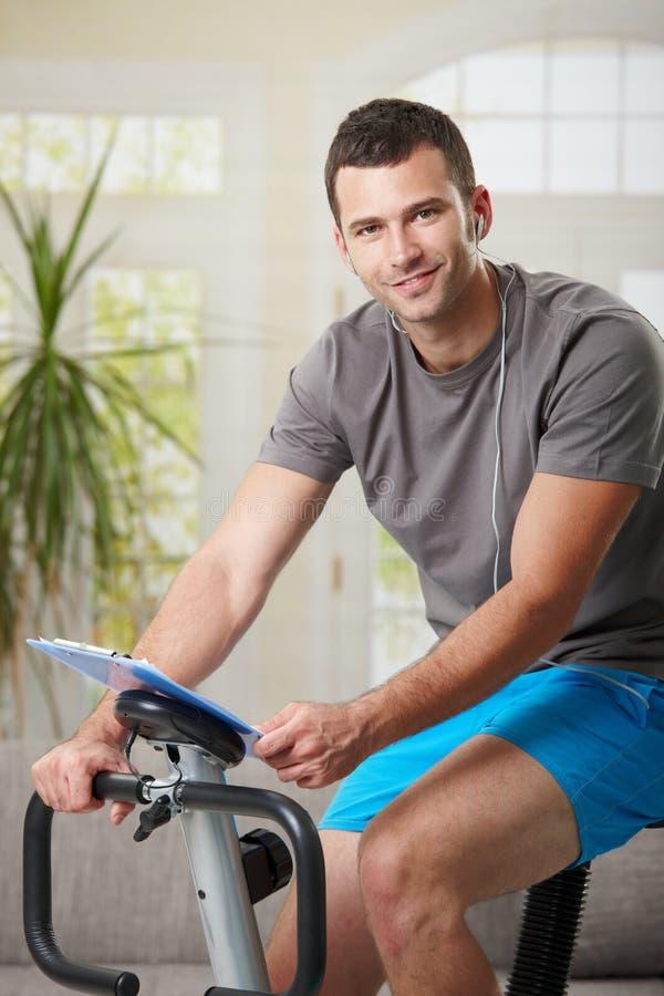 Download Man Training On Exercise Bike Stock Image - Image: 24850739