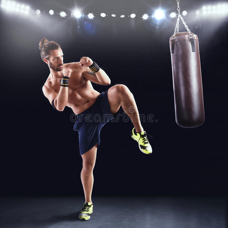 Man is training with the punching bag stock photography