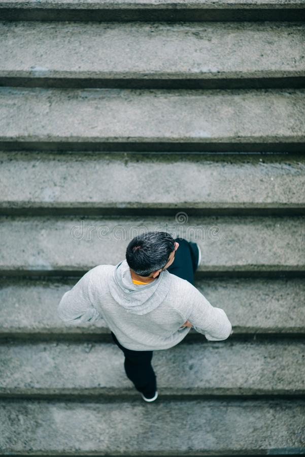 Man training on urban stairs royalty free stock images