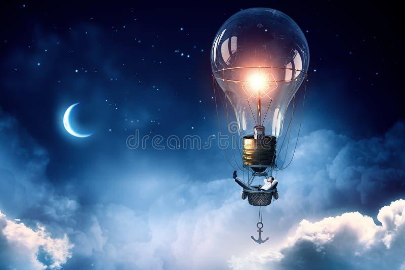 Man travel in aerostat. Businessman flying on aerostat balloon high in sky royalty free stock photography