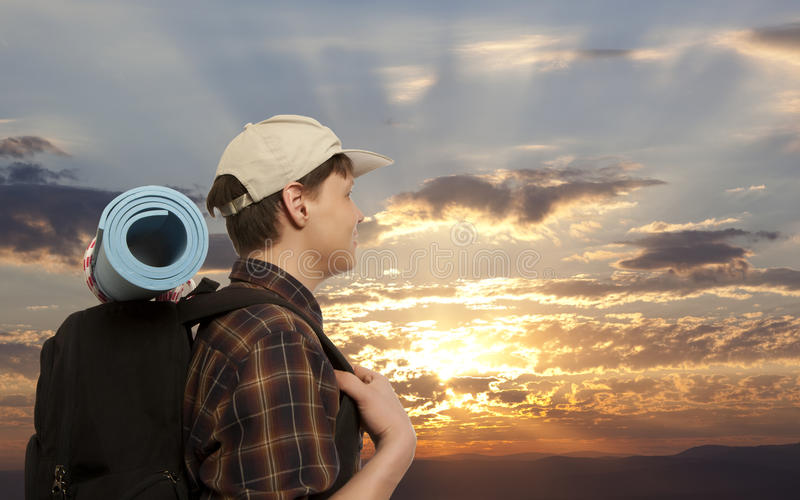 Man with a travel backpack stock photos