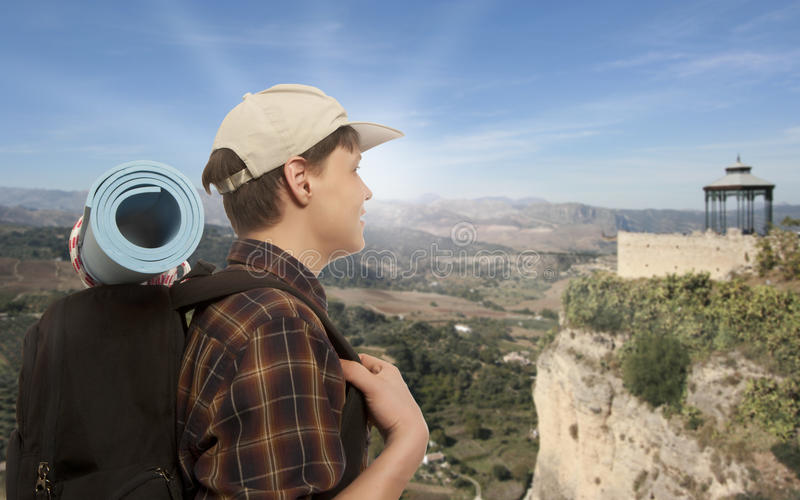 Man with a travel backpack stock photography
