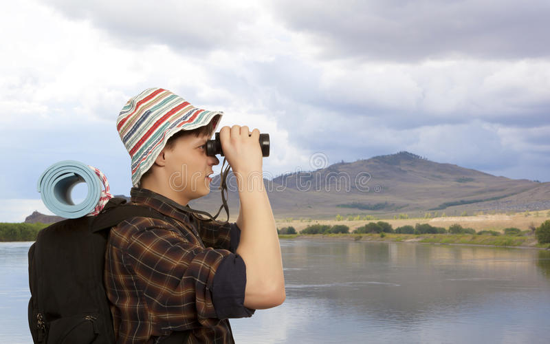 Man with a travel backpack royalty free stock image