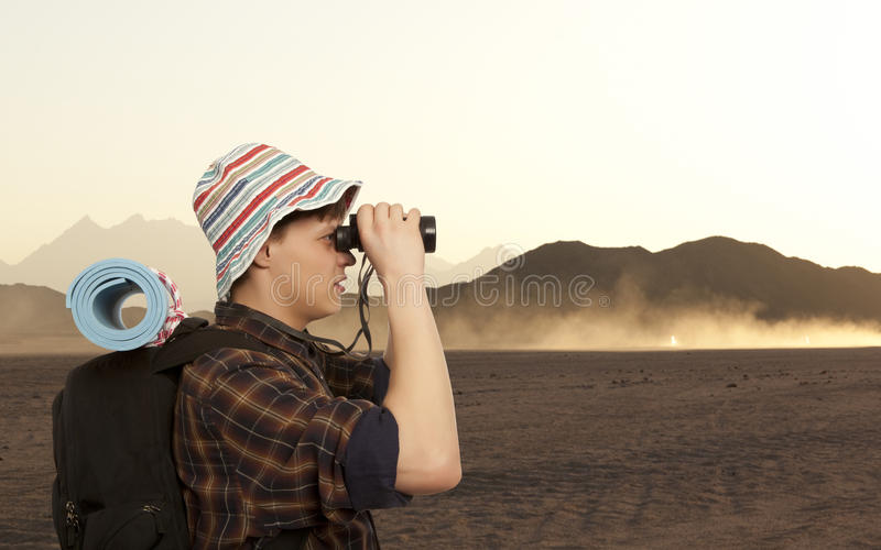 Man with a travel backpack stock photo