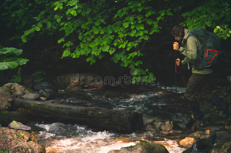 Man Traveler with backpack hiking outdoor royalty free stock image