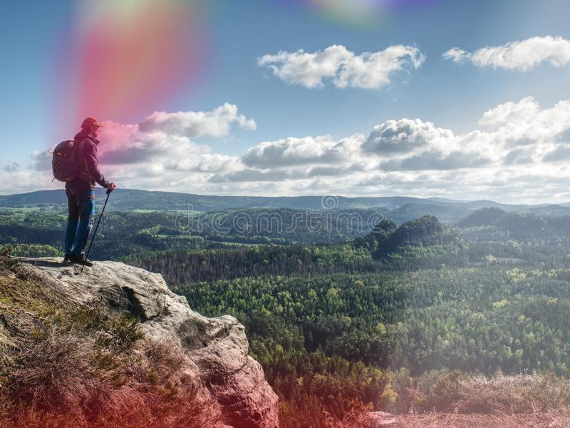 Man Traveler with backpack is mountaineering. Adventure Concept stock photo