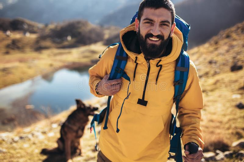 Man Traveler with backpack mountaineering . Travel Lifestyle concept lake and mountains on background Summer expedition vacations outdoor royalty free stock photo