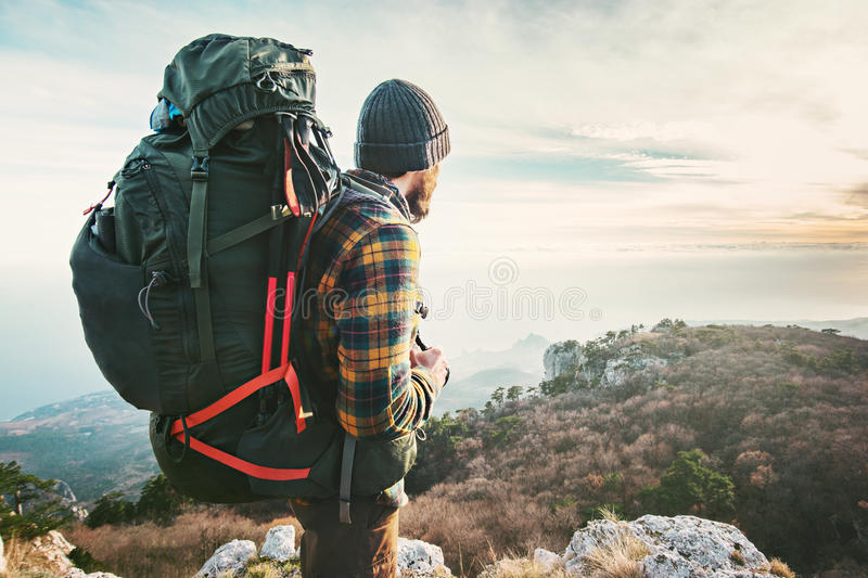 Man Traveler with big backpack hiking mountains expedition stock photo