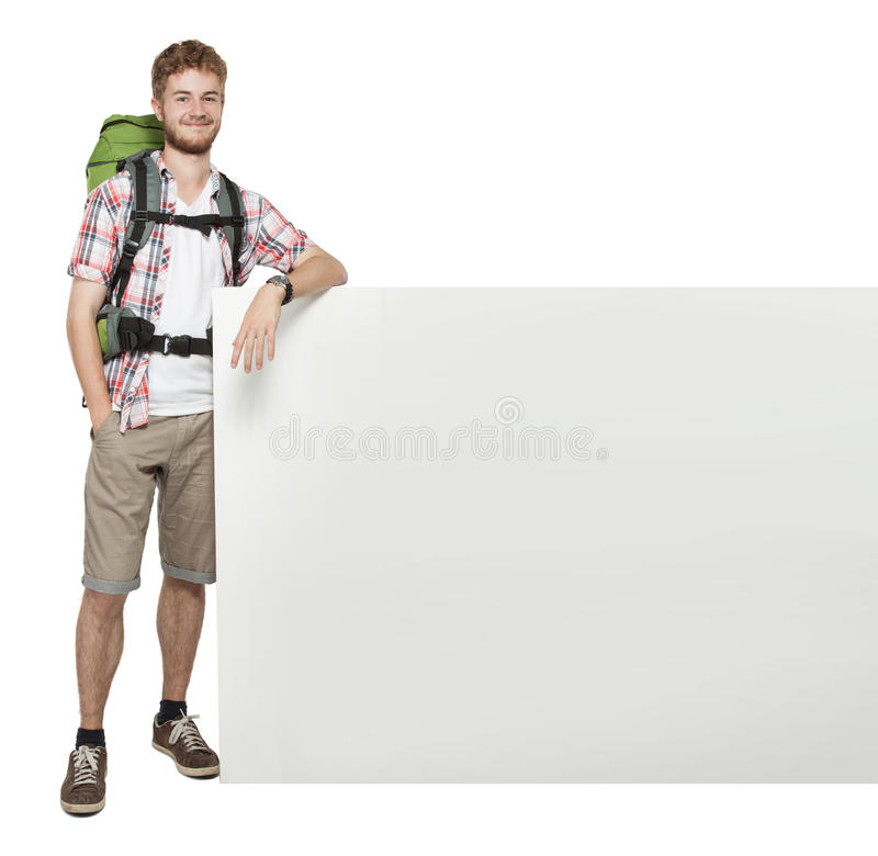 Man traveler with blank space board poster. Young man traveler with blank space board poster stock photo