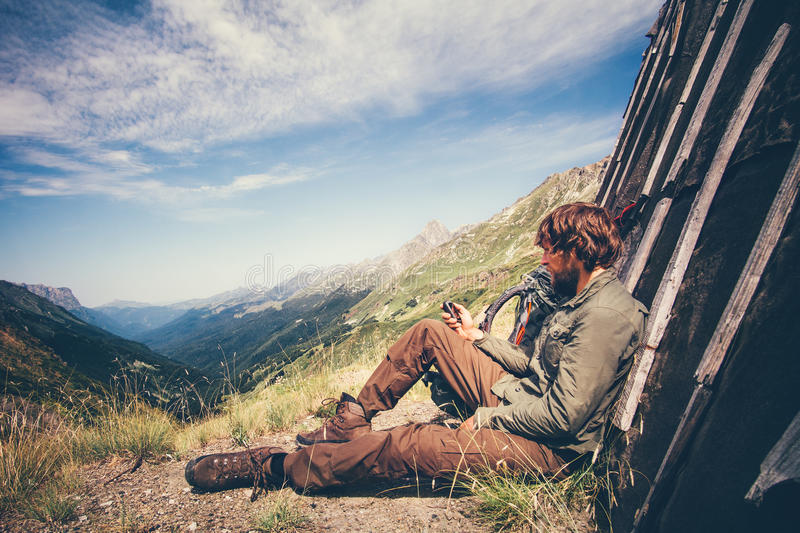 Man Traveler with navigator tracker relaxing alone. Travel Lifestyle concept mountains and clouds on background Summer adventure vacations outdoor stock photos