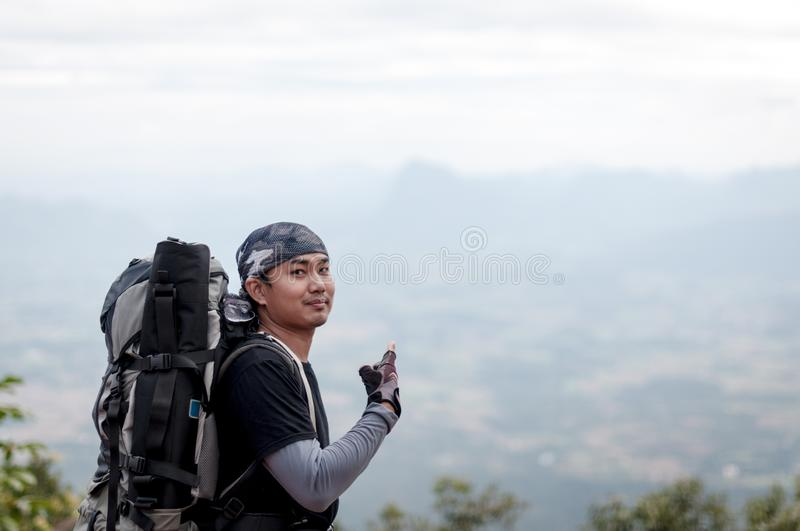 Closeup of man traveler portrait with landscape on mountain royalty free stock photos