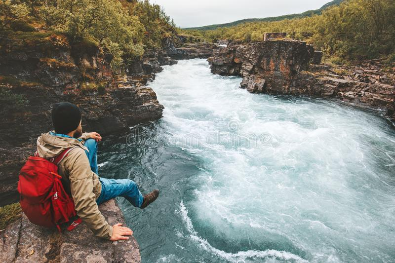 Man traveling relaxing alone with river canyon view. Adventure lifestyle hiking adventure vacations outdoor exploring Sweden stock photos
