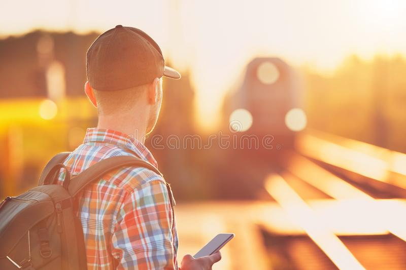 Man traveling by train stock photo