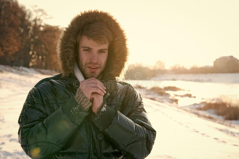 Man traveling in winter, nature. Warm clothes for cold season. Sexy man in winter clothes. Winter fashion. Green warm stock photos