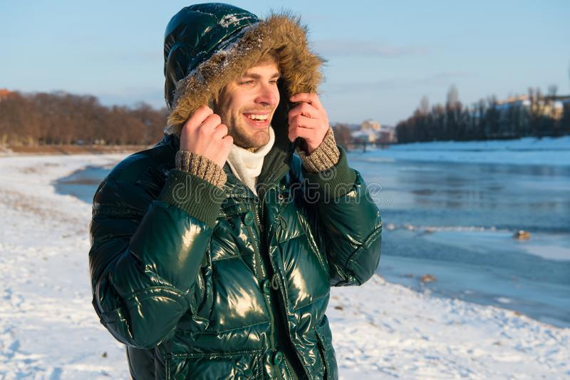 Man traveling in winter, nature. Winter fashion. Green warm coat. Warm clothes for cold season. man in winter stock photography
