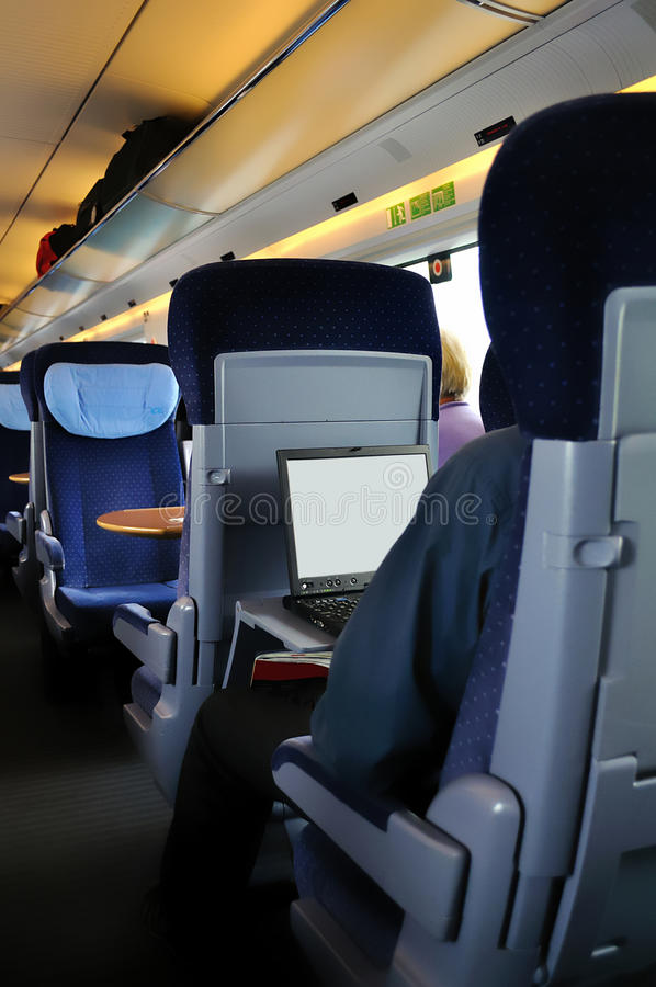 Man traveling and working in train royalty free stock image