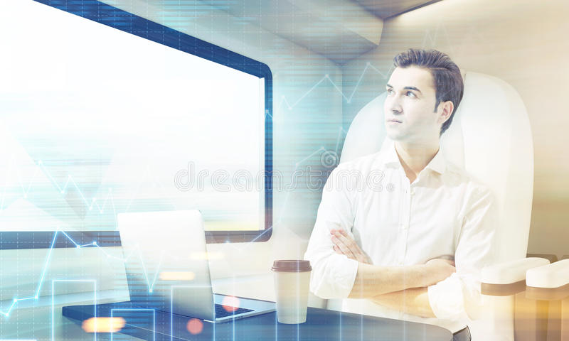 Man travelling in train compartment with graphs royalty free stock image
