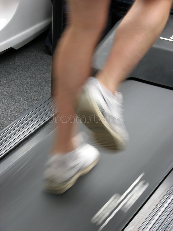 Man on treadmill. Male running on gymnasium treadmill
