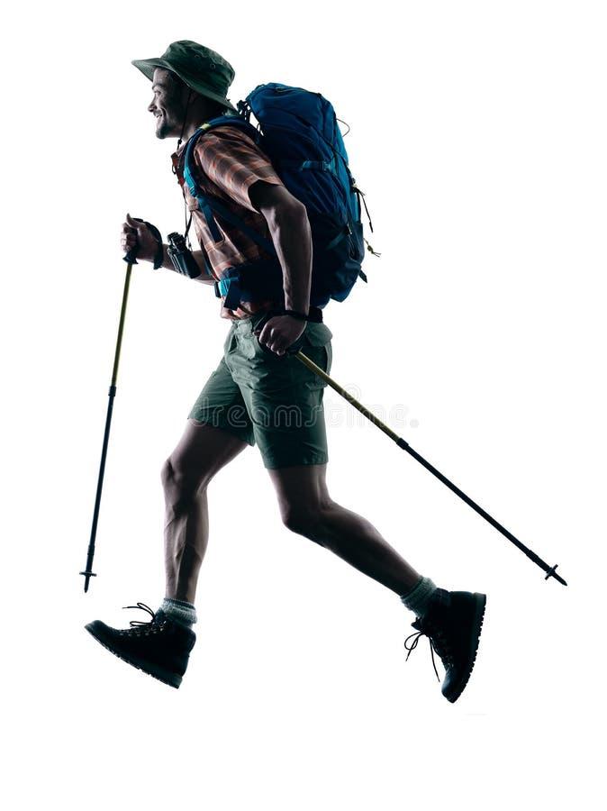 Man trekker trekking running happy silhouette. One caucasian man trekker trekking running happy in silhouette isolated on white background royalty free stock images