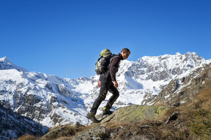 Man trekking in the Alps. Grand Paradiso National Park. Italy royalty free stock image