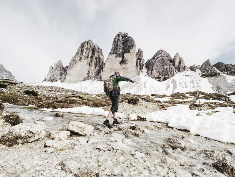 Man trekking in the Alps. Mountain ridge of Tre Cime royalty free stock images