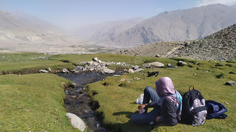 Man trekking in Ishkashim green valley, mountains in Afghanistan stock images