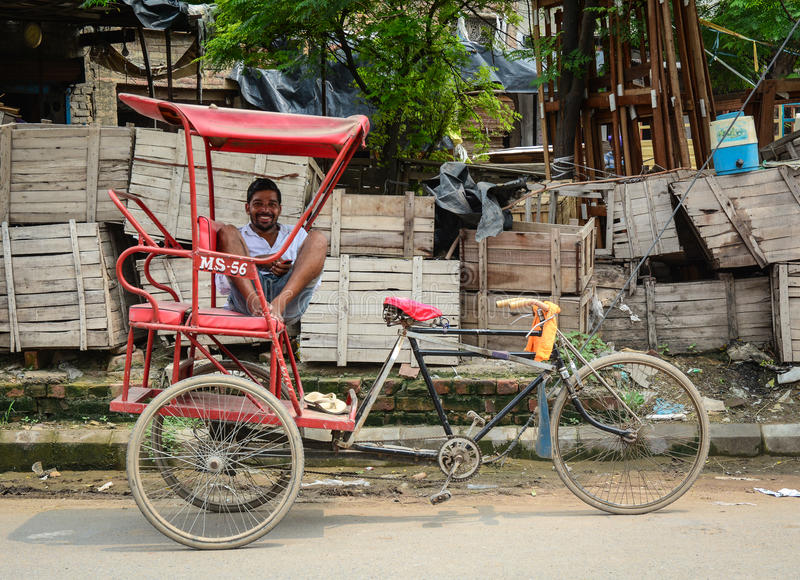 A man with tricycle on street in Amritsar, India royalty free stock images