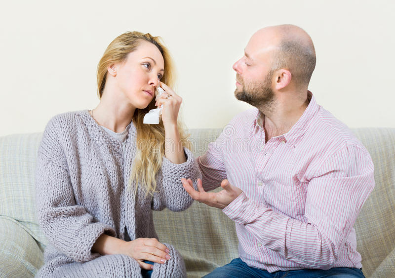 Man tries reconcile with woman. Man tries reconcile with crying women in home. Focus on girl stock image